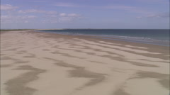Low Over Sand And Sea Towards Holy Island Stock Footage