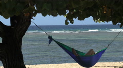 Stock Video Footage of Chilled Out in A Tropical Beach Hammock 4K