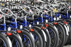Bicycles bicycle rental facility Alexanderplatz square Berlin Germany Europe - stock photo