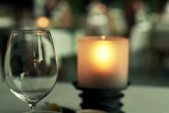 Empty wine glass on table in cafe at night NTSC Stock Footage