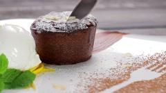 Warm cut chocolate fondant with ice cream and cinnamon. Stock Footage