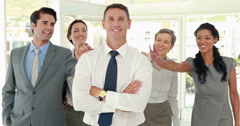 Stock Video Footage of Business people congratulating their colleague
