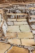 Salt mines of Maras Sacred Valley of the Incas Urubamba Peru South America - stock photo