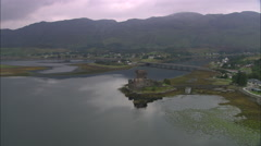AERIAL United Kingdom-Eilean Donan Castle On Loch Duich Stock Footage