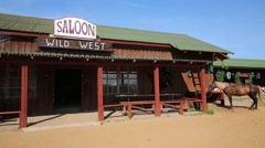 Wild West saloon building, made of wood with a horse tied Stock Footage