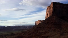 Timelapse- sun rising on a shear cliff of Mitchell Mesa in Monument Valley. Stock Footage