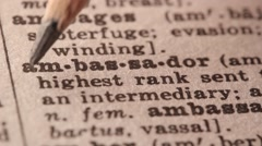 Ambassador - Fake dictionary definition of the word with pencil underline Stock Footage