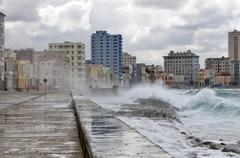 Waves washing over the Malecon Centro Habana Havana Ciudad de La Habana Cuba Stock Photos