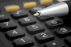 Bussines Calculation Pen - stock photo