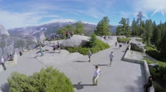 Tourists walk by observation area in Yosemite National Park - stock footage