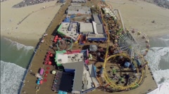 Amusement park on Santa Monica Pier at autumn sunny day. Stock Footage