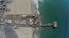 Santa Monica beach with amusement park on pier at autumn Stock Footage