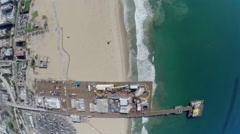 Sand beach with amusement park on pier Santa Monica at autumn Stock Footage