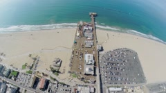 Sand beach with parking place and amusement park on pier Stock Footage