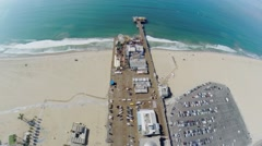 Pacific ocean beach with amusement park on pier Santa Monica Stock Footage