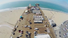 Pacific Park on Santa Monica Pier at sunny day. Aerial view. Stock Footage