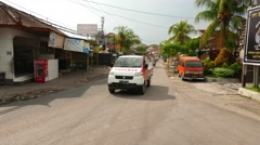 Busy traffic at Jalan Gunung Soputan, perspective view Stock Footage