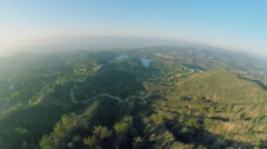 Townscape with Hollywood Lake at autumn sunny day. Aerial view Stock Footage