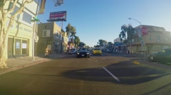 People in black Mustang ride by Mission Boulevard at autumn - stock footage