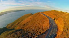 Shore of pacific ocean with Conzelman road in mountains at autumn Stock Footage