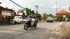 Busy Gunung Soputan street, intersection with Gunung Lumut Stock Footage