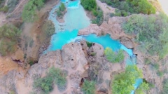 People stand on top of Havasu Creek above waterfall at autumn day Stock Footage