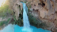 Small cave and waterfall on Havasu Creek at autumn sunny day Stock Footage