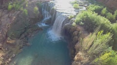 Stock Video Footage of Waterfall from precipice in Grand Canyon at autumn sunny day