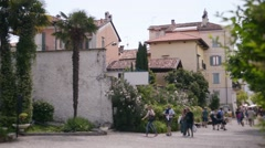Embankment of the european town, tourists walking streets - Italy Lago Maggiore Stock Footage