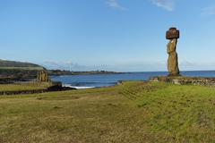 Moai wearing a Pukao topknot Tahai ceremonial complex Hanga Roa Rapa Nui Stock Photos