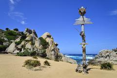 Decorated pole of the hippies in the Valle della Luna Capo Testa Province of - stock photo