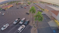 Parking place near trade center at autumn evening during sunset Stock Footage
