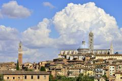 Historic centre with the cathedral of Siena Cattedrale di Santa Maria Assunta - stock photo