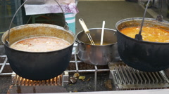 Outdoor Cauldrons with Food Stock Footage
