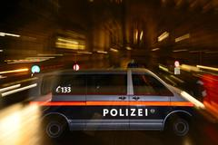 Police car in action demonstration against PEGIDA at the Opernring Innere Stadt - stock photo