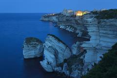 Stock Photo of The medieval old town on the limestone cliff at dawn Bonifacio CorseduSud