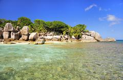 Granite rocks uninhabited island of Ile Cocos Coco Iceland Praslin Seychelles - stock photo