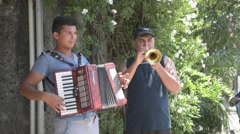 musicians playing on street old European town - stock footage