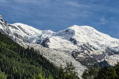 Mont Blanc 4810m with the mountains Dome du Gouter and Pointe Bayeux and the - stock photo
