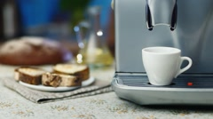 The coffee machine makes coffee in the background bread breakfast Stock Footage