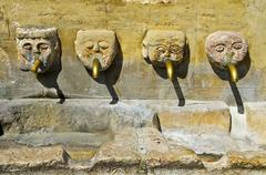 Stock Photo of Four gargoyles by the village well Grazalema Andalucia Spain Europe