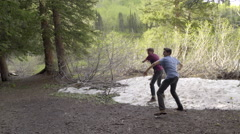 Teenagers Find Snow At High Altitude In Summer, They Throw Snowballs At Friends Stock Footage