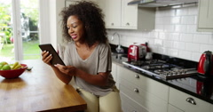 An attractive woman video chatting on a digital tablet  Stock Footage