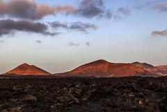 Lava field Fire Mountains volcanoes volcanic landscape evening light Lanzarote Kuvituskuvat