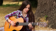 Girl composes music with a guitar Stock Footage