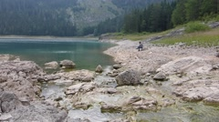 Woman contemplating mountains lake Stock Footage
