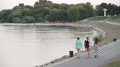 Girls walking at the bank of Danube Stock Footage