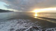 Dark Clouds, Waves, and Golden Sun Stock Footage