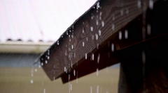 From The Rooftop Rain Water Falls On A Stormy Day In Winter Or Spring HD - stock footage