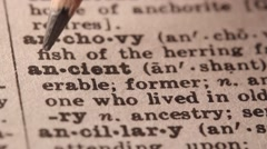 Ancient - Fake dictionary definition of the word with pencil underline Stock Footage